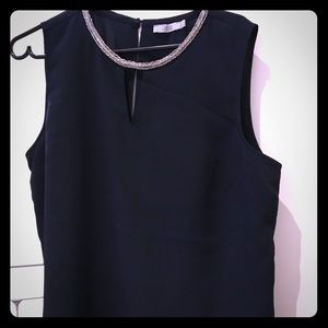 Navy blue blouse, with jewel detail on neckline